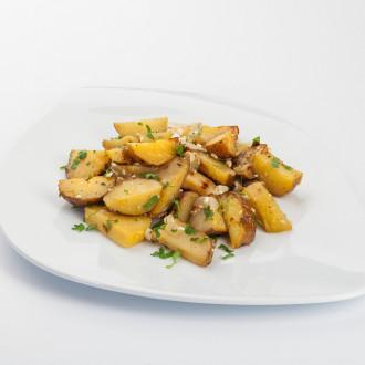 Картопля печена з цибулею та сиром